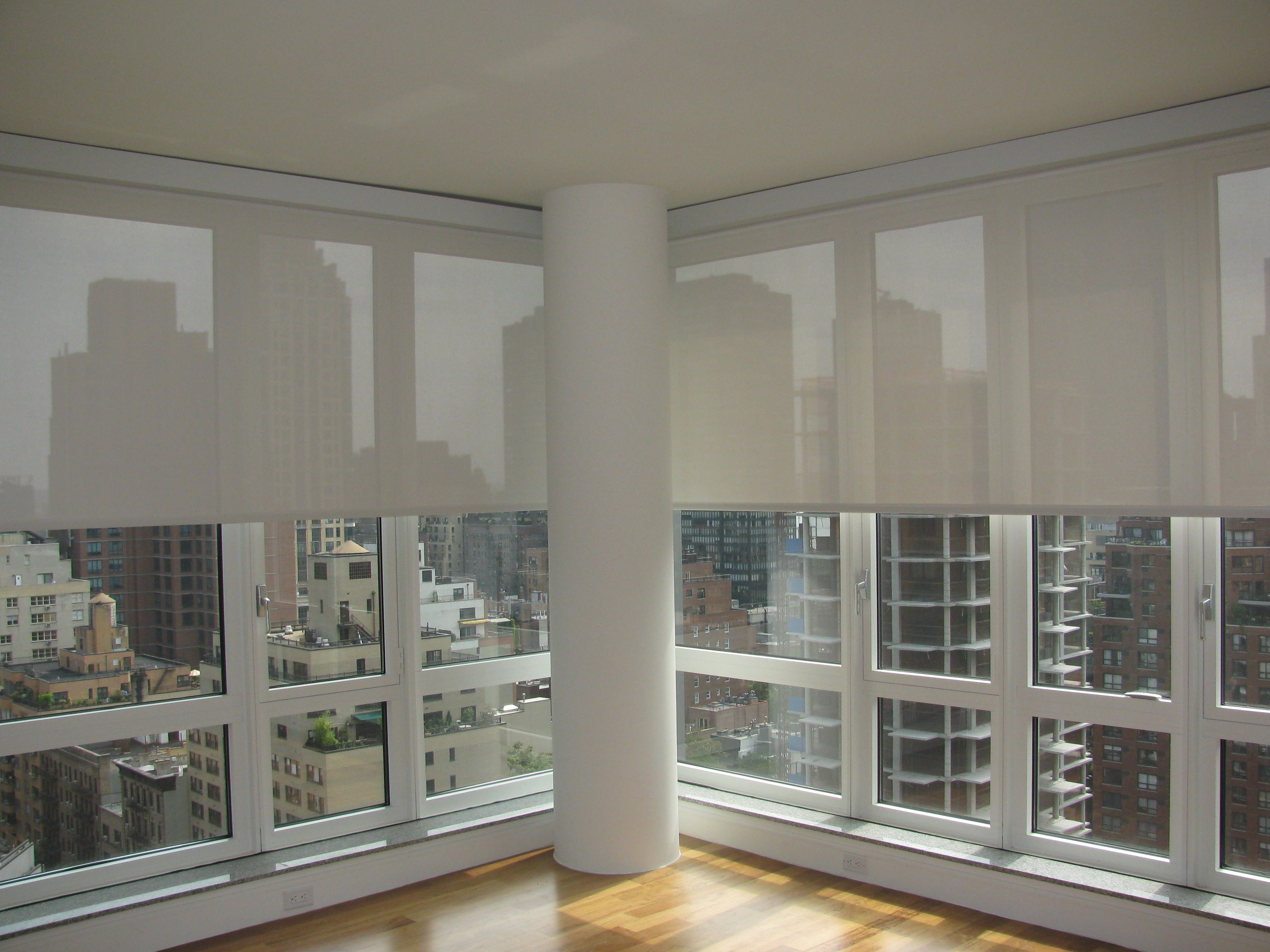 Motorized blinds roller blinds in dubai curtains dubai for Motorized shades home depot